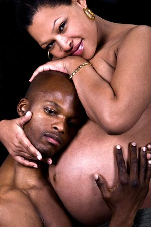African American couple, pregnant, woman mixed race african , hispanic . photo