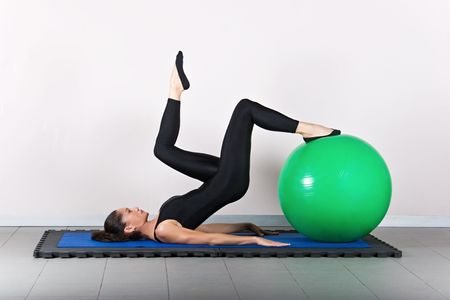 hamstring: Hamstring curl one leg   with ball position. Pilates gymnastics is a Germanic evolution of yoga, used by athletes to improve flexibility and body fitness and by chiropractors for patient recovery.