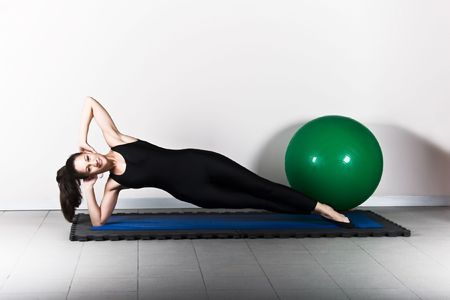 plank position: Side plank with ball position. Pilates gymnastics is a Germanic evolution of yoga, used by athletes to improve flexibility and body fitness and by chiropractors for patient recovery.
