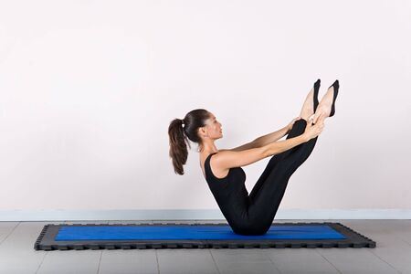 midlife: Teaser exercise. Pilates gymnastics is a Germanic evolution of yoga, used by athletes to improve flexibility and body fitness and by chiropractors for patient recovery.