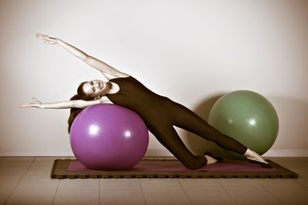 germanic: Pilates gymnastics is a Germanic evolution of yoga, used by athletes to improve flexibility and body fitness and by chiropractors for patient recovery. Vignette vintage sepia look