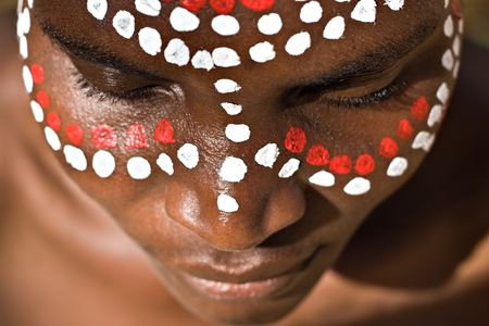 Young African girl, tribal painted face in white and red Stock Photo