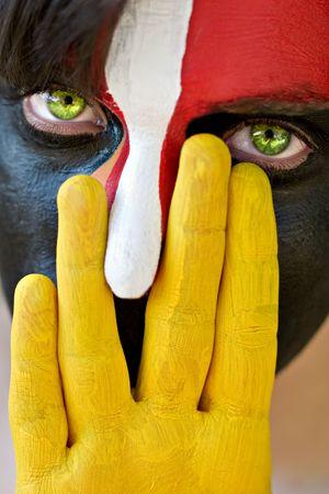 Young man with colorful painted face, conceptual photo