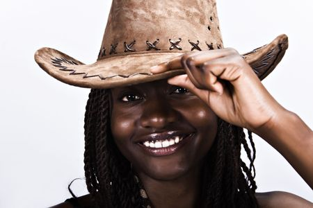 Young African woman smiling, with cowboy hat and dreadlocks hairstyle photo