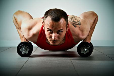 Push up with dumbbells, classic endurance exercise for biceps photo