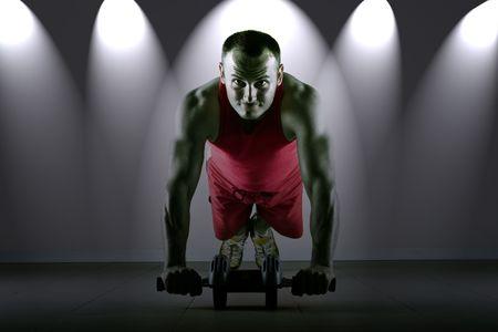 Push up with exercise wheel dramatization, classic endurance workout for biceps Stock Photo - 2113311