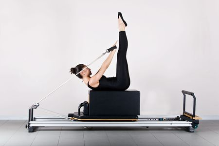 Backstroke position. Pilates gymnastics is a Germanic evolution of yoga, used by athletes to improve flexibility and body fitness and by chiropractors for patient recovery. Stock Photo - 2163020