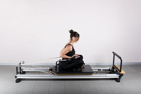 Push curls  position. Pilates gymnastics is a Germanic evolution of yoga, used by athletes to improve flexibility and body fitness and by chiropractors for patient recovery. Stock Photo - 2163022