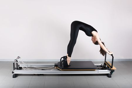 Elephant  position. Pilates gymnastics is a Germanic evolution of yoga, used by athletes to improve flexibility and body fitness and by chiropractors for patient recovery.