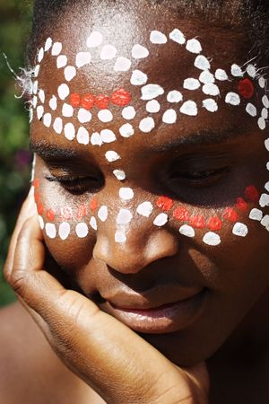 painted image: Young African girl, tribal painted face in white and red, this image is a straight RAW conversion, with powerfull highlights to emphase the black skin, so if you are after a standard