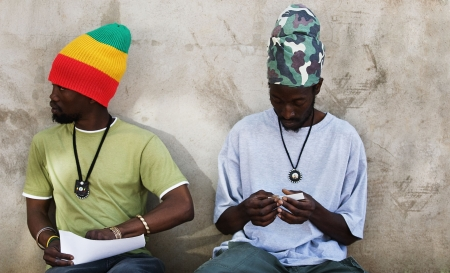 Rastafarian men smoking cannabis photo