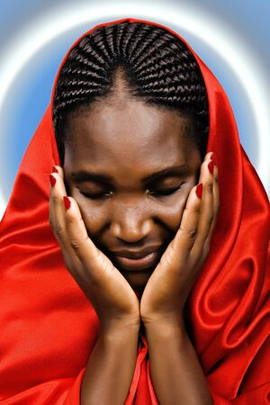 Religious African American woman praying with closed eyes photo