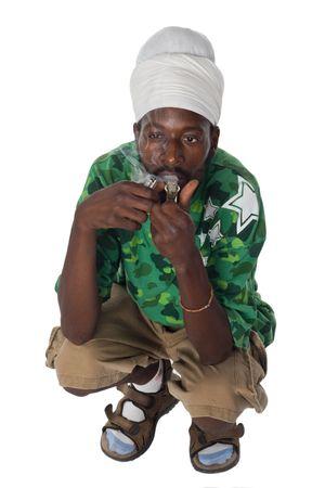 man smoking: portrait of rasta man smoking marijuana from a pipe