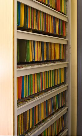 hundreds: Doctor�s metallic cabinet with hundreds of colorful files Stock Photo