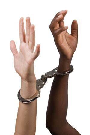 jailed: Mixed race hands Caucasian African American, man and woman, with handcuffs