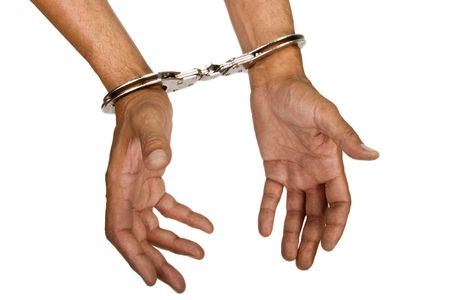 Man hands with handcuffs top view Stock Photo - 2595991