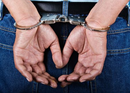 Man handcuffed hands at the back Stock Photo - 2596305