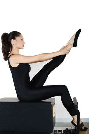 Pilates gymnastics is a Germanic evolution of yoga, used by athletes to improve flexibility and body fitness and by chiropractors for patient recovery. Stock Photo - 2764240
