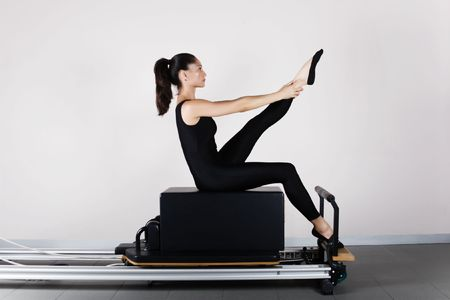 Pilates gymnastics is a Germanic evolution of yoga, used by athletes to improve flexibility and body fitness and by chiropractors for patient recovery. photo