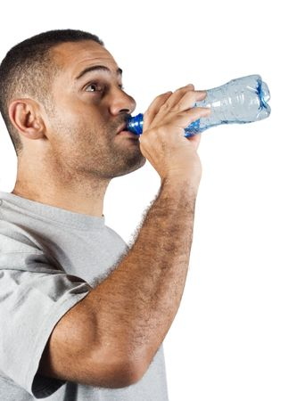 slurp: Thirsty young man drinking water from a plastic bottle