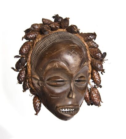 Collection of vintage African masks different styles South Africa, Congo, Chad, Kenya, Uganda, Stock Photo