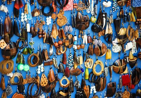 Traditional African jewelry earrings display on blue photo