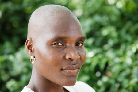 Bald and beautiful typical African woman. Stock Photo