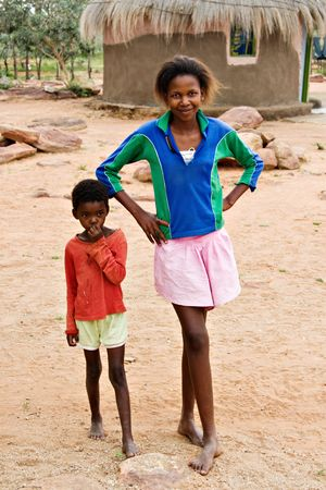 kalahari desert: African children brother and sister, social issues, poverty, village near Kalahari desert