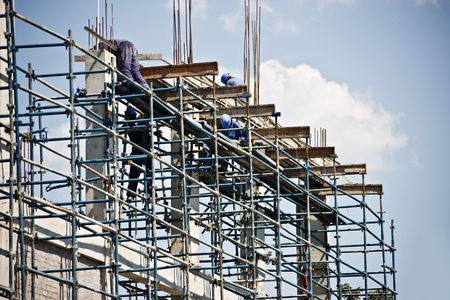 climbed: construction workers climbed on scaffolding,  Stock Photo