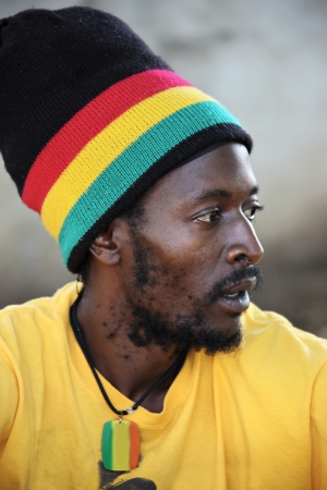 rastafari: portrait of young rasta man in traditional clothes
