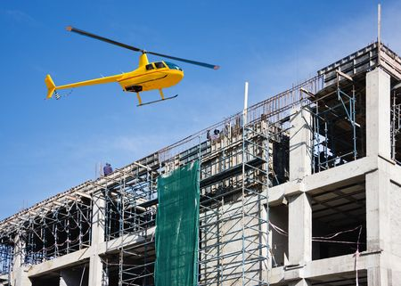 Helicopter on site visiting the construction stage