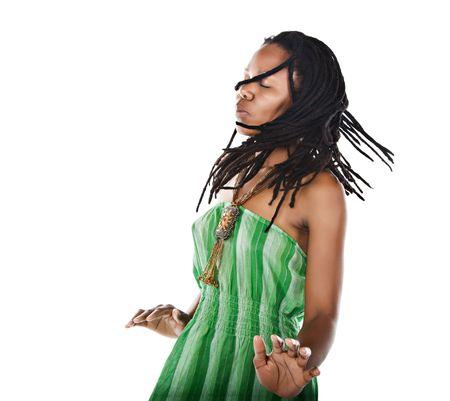 Rasta woman dancing reggae with closed eyes feeling the music