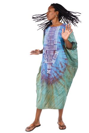 African woman in traditional clothing dancing away