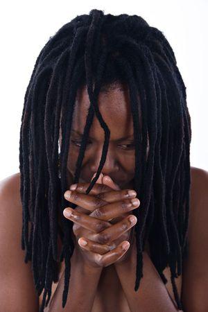 dreadlock: portrait of sad Rastafarian  girl with dreadlocks and overworked hands, focus on hands Stock Photo