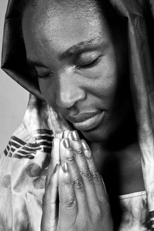 native african ethnicity: Young woman Zimbabwe, traditional clothing, Christian look Stock Photo
