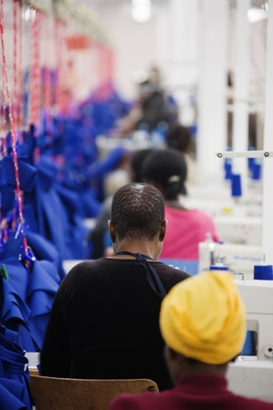 factory worker: Industrial size textile factory in Africa, African workers on the production line