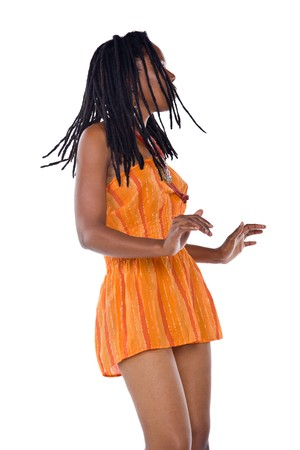 Rasta woman with orange dress dancing reggae Stock Photo