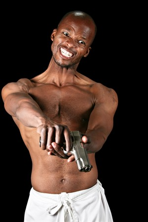 dangerous man: African man with a pistol isolated on black