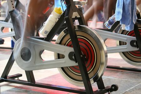 blur motion of people having a training session on spin bikes Stock Photo