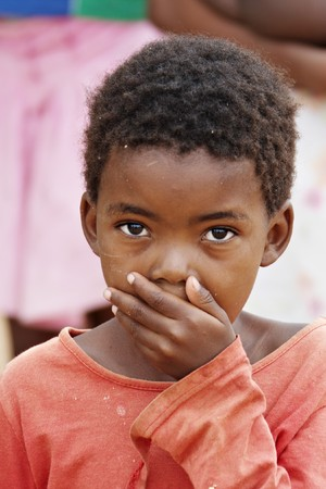African deprived child in a village near Kalahari Desert Stock Photo