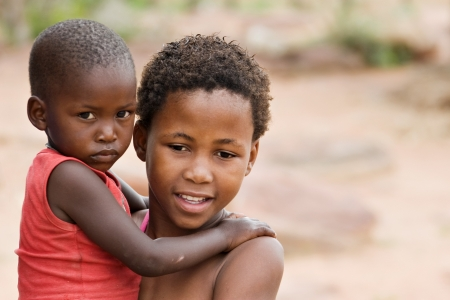 poor woman: African brother and sister deprived children in a village near Kalahari Desert Stock Photo