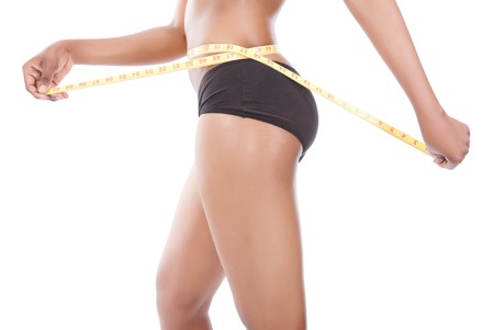 kilograms: African woman diet concept with measuring tape Stock Photo