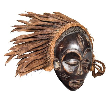 primitive art: Traditional vintage African mask made from hard wood
