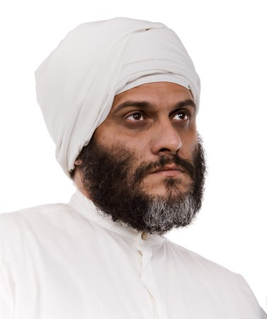 Muslim man with beard and turban isolated on white photo