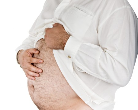 hairy arms: Overweight middle age man with a fat tummy