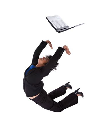 Acrobatic businesswoman doing a flip with a laptop Stock Photo - 4117898