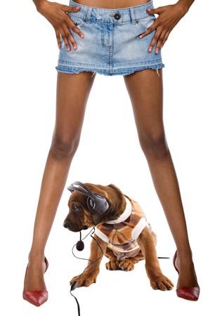 ridgeback: Rhodesian ridgeback puppy, listening music, sitting between legs of African girl, composite photo