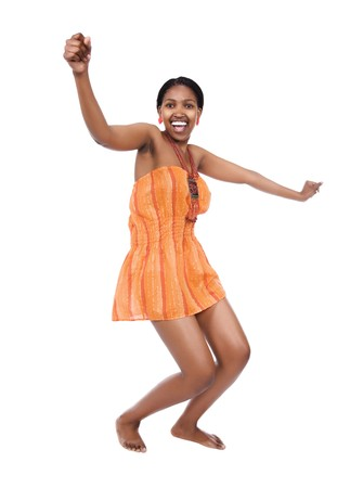 Beautiful young African woman with braids dancing
