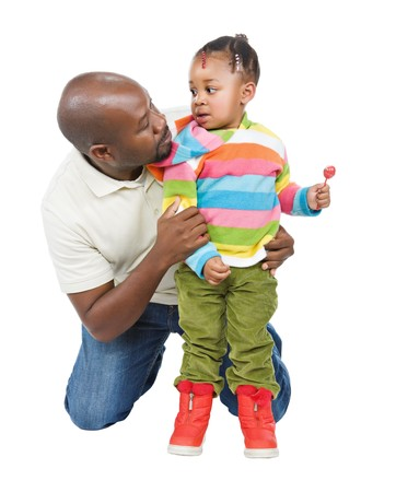 fatherhood: The father and his cute little African girl with a colorful sweater  Stock Photo