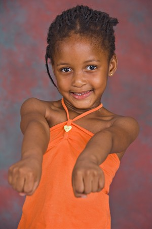 portrait of african girl with orange blouse Stock Photo